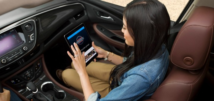 girl using a tablet in the car