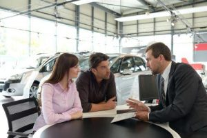 couple talking to a salesman