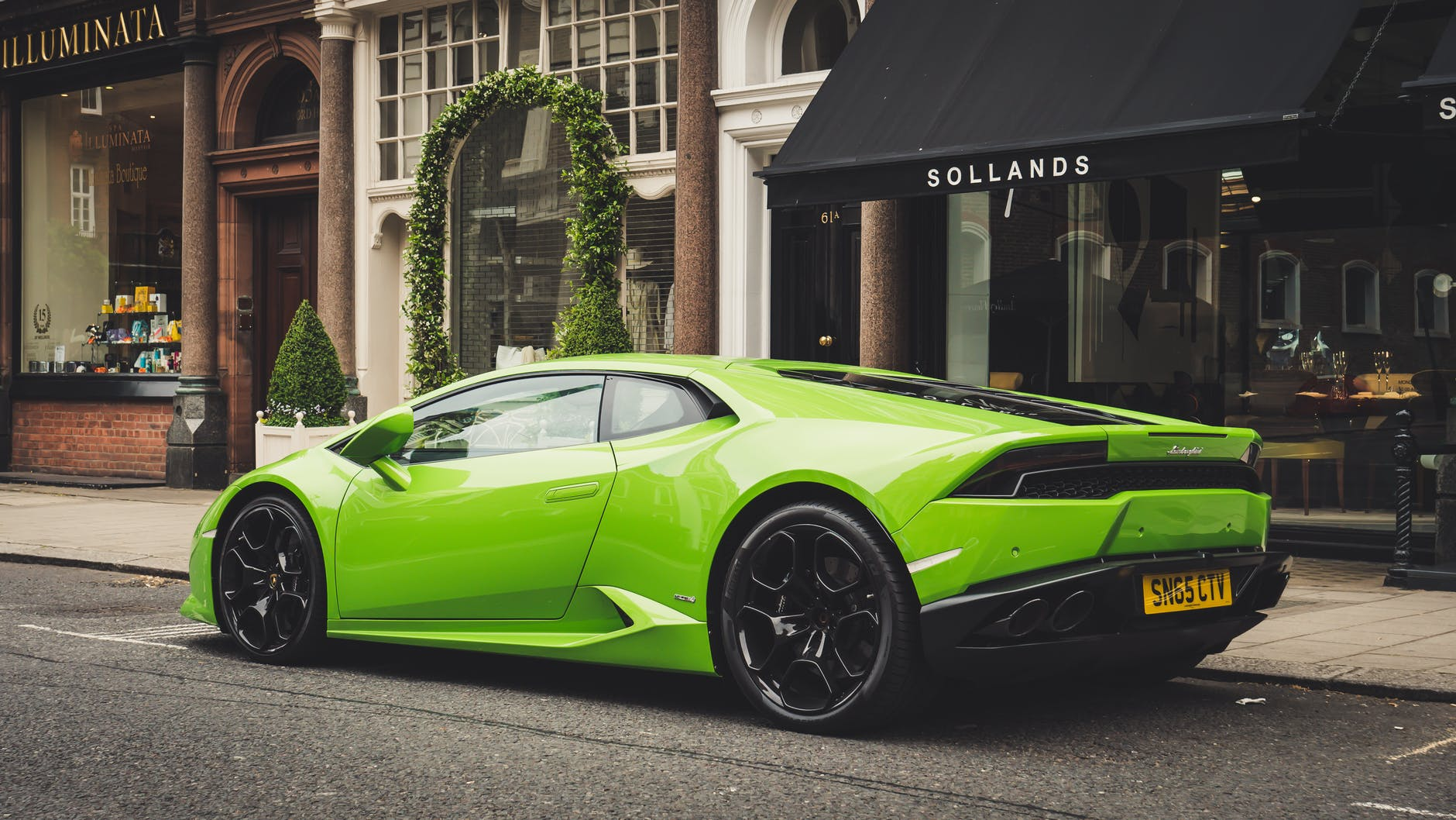 photo of parked lime green lamborghini