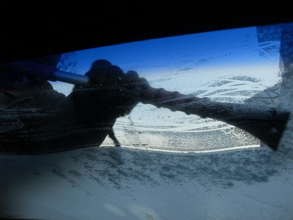 person cleaning the car window